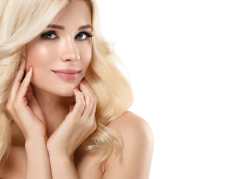 blonde model with hands framing face