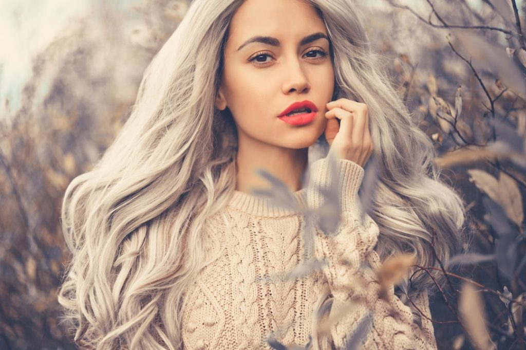 model standing outside with silver grey hair